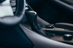 Selector automatic transmission with perforated leather in the interior of a modern expensive car. The background is blurred royalty free stock photos