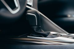 Selector automatic transmission with perforated leather in the interior of a modern expensive car. The background is blurred royalty free stock images