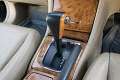 Automatic transmission gear shift. Car interior decorate wood. Automatic transmission gear shift Stock Images