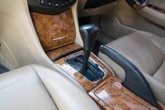 Automatic transmission gear shift. Car interior decorate wood. Automatic transmission gear shift Stock Photos