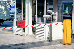 Automatic vehicle Security Barriers with security camera. Outdoor at office Stock Image