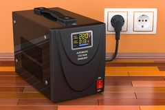 Automatic voltage stabilizer on the wooden floor connected to outlet. 3D rendering royalty free stock photography
