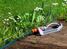 Automatic watering lawns device Stock Photo