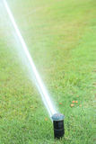 Automatic watering system on grass Stock Photography