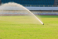 Automatic watering system on grass Stock Image