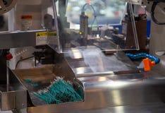 Automatic Cut, Strip and Crimp Machine stock image