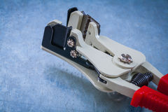 Automatic wire strippers on scratched metallic background top vi Royalty Free Stock Photography