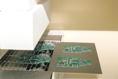 Automation of machine assembly of computer circuit board in the factory for the production of computer components. The. Process of soldering the board. Factory Royalty Free Stock Images