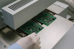 Automation of machine assembly of computer circuit board in the factory for the production of computer components. The. Process of soldering the board. Factory Royalty Free Stock Photo