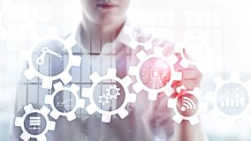 Automation technology and smart industry concept on blurred abstract background. Gears and icons. Automation technology and smart industry concept on blurred stock photos
