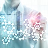 Automation technology and smart industry concept on blurred abstract background. Gears and icons. Automation technology and smart industry concept on blurred stock images