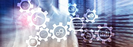 Automation technology and smart industry concept on blurred abstract background. Gears and icons. royalty free stock photo