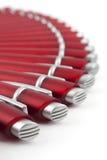 Automatischer roter Ballpoint angeordnet wie ein Gebläse lizenzfreies stockfoto