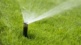 Automatisches Bewässerungssystem der Düse gegen Stockfoto