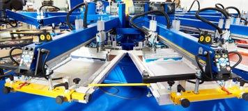 Automatisk karusell för maskin för skärmutskrift arkivbild