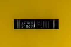 Automatiskt svart vitt mekaniskt för abstrakta gula tusentals för biljetträknare royaltyfria foton