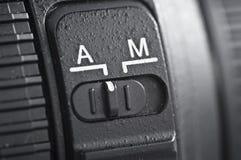 automatyczny kamery obiektywu manuał vs Zdjęcie Royalty Free