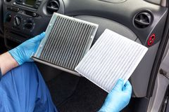 Clean and dirty car cabin air filter Stock Images