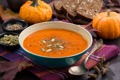 Automn pumpkin soup in a bowl on table Stock Photos