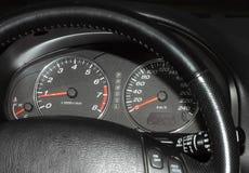 Automobiele snelheidsmeter en tachometer Royalty-vrije Stock Foto's
