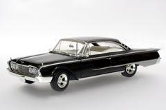 Automobile 1960 del giocattolo della scala del metallo del Ford Starliner Immagini Stock Libere da Diritti