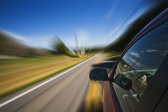 Automobile. Driving down road with a blured affect Royalty Free Stock Photos