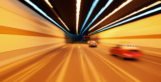 Automobile ad alta velocità nel tunnel Fotografia Stock Libera da Diritti