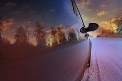 Automobile al tramonto Immagini Stock Libere da Diritti