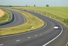 Automobile all'alta velocità sulla strada principale Immagini Stock Libere da Diritti