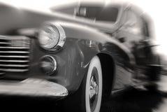 Automobile antica nel movimento Immagini Stock