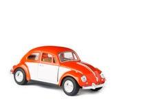 Automobile arancio del giocattolo Immagini Stock