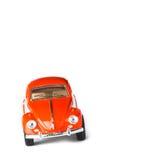 Automobile arancio del giocattolo Fotografie Stock Libere da Diritti