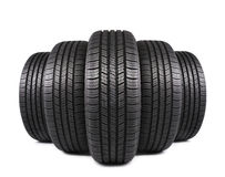Automobile black rubber tires on white Royalty Free Stock Photos