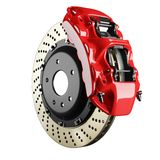 Automobile brake disk and red caliper. Automobile braking system. Aeration steel brake disk with perforation and red six pistons calipers and pads. Tuning auto Stock Image