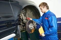 Automobile brake liquid replacing Stock Photos