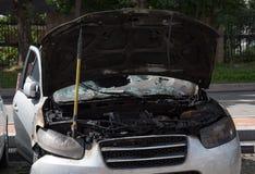 Automobile bruciata Immagini Stock