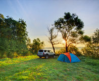 Automobile and camp on sunrise Stock Photography