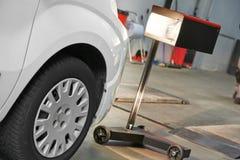 Automobile car headlight checkup Stock Image