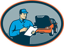 Automobile car repair mechanic. Illustration of a Automobile car repair mechanic with clipboard set inside an oval Stock Photography