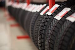 Automobile car tires on showcase royalty free stock photography