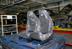 Automobile chairs in packing stand in assembly shop of automobil. E plant Stock Image