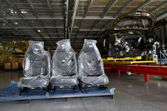 Automobile chairs in packing stand in assembly shop of automobil Stock Photo