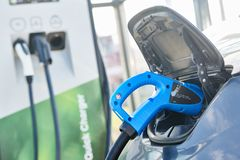 Electric car charging. Ecological automobile royalty free stock photography