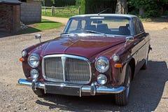 Automobile classica britannica marrone rossiccio Immagini Stock