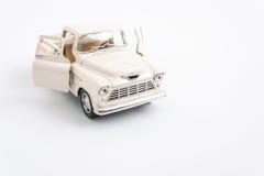 automobile classica del giocattolo su bianco Immagini Stock Libere da Diritti