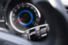 Automobile comfort wiper operating switch. Close-up of vehicle-operated instrument panel and wiper operating switch Royalty Free Stock Images