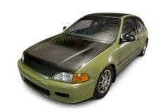 Automobile compatta di sport verde su bianco Fotografia Stock Libera da Diritti