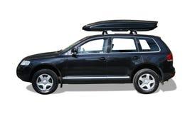 Automobile con il contenitore di tetto immagine stock