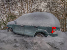 Automobile covered in a pile of snow Stock Photography