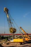 Automobile crane. A yellow automobile crane at a construction site Royalty Free Stock Photo